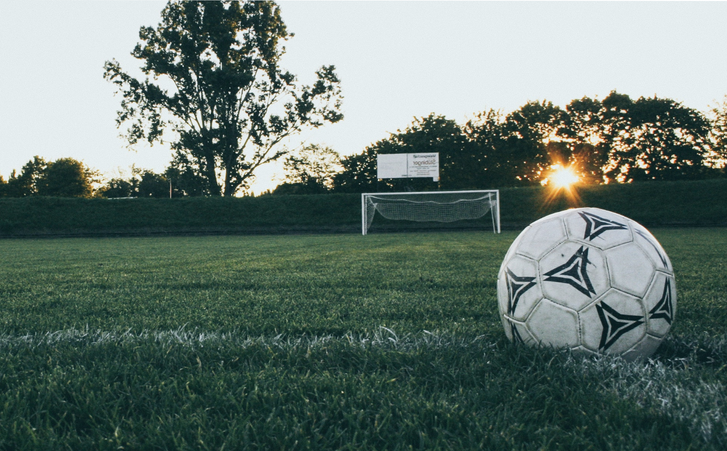 Homepage header image of soccer ball on a soccer field