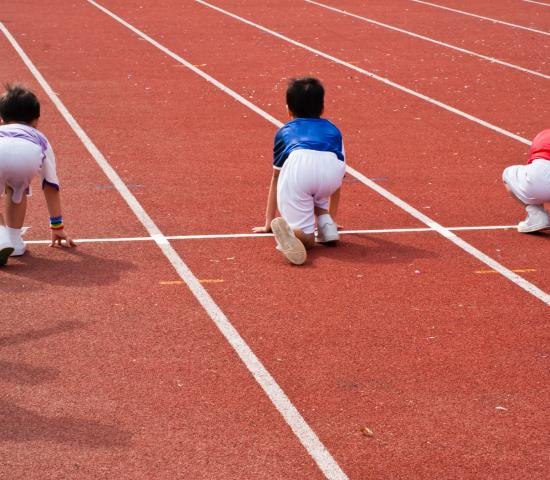 children stretching at a track