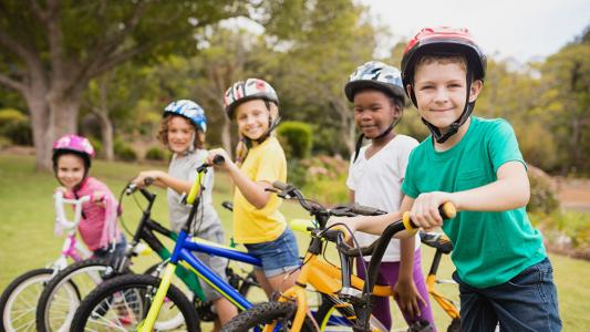 children side by side on bikes