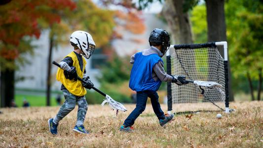 children playing lacrosse